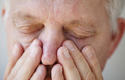 Sinus problems in senior man Royalty Free Stock Photography