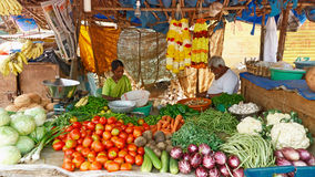SIOLIM, GOA, INDIA - CIRCA DECEMBER 2013: Elderly couple sells v Royalty Free Stock Photo