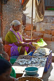 SIOLIM, GOA, INDIA - CIRCA DECEMBER 2013: An elderly woman sells Stock Images
