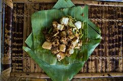 Siomay - Indonesian dish with steamed fish dumpling and vegetables served in peanut sauce in banana leaf, view from top.  stock photo