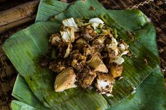 Siomay - Indonesian dish with steamed fish dumpling and vegetables served in peanut sauce in banana leaf in close-up.  stock photo