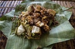 Siomay - Indonesian dish with steamed fish dumpling and vegetables served in peanut sauce in banana leaf.  royalty free stock image
