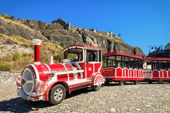 Red excursion train old town of Sion Valais Switzerland. Sion, Switzerland - August, 25, 2016: Red excursion train in the old town of Sion, Canton Valais stock photos