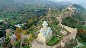 Sioni orthodox church and Narikala fortress, Georgia, topshot stock video