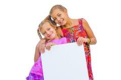 Siostry trzyma sztandar Obrazy Royalty Free