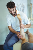 siotherapist giving leg massage to a woman Stock Images