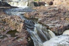 Sioux Falls Waterfall. A rushing river over falls in South Dakota Stock Photos
