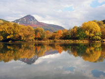 Sip hill and Vah river in autumn. Colorful autumn view of peak of hill Sip (alt. 1 169.5 meters), a massive rocky hill towering above the confluence of the Vah Stock Images