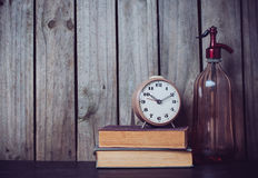 Siphon, alarm clock and vintage books Royalty Free Stock Image