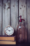 Siphon, alarm clock and vintage books Stock Image