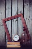 Siphon, alarm clock and vintage books Royalty Free Stock Photography