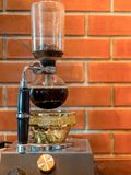 Siphon vacuum coffee maker. Preparation Royalty Free Stock Image