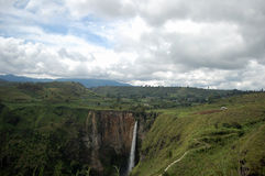 Sipiso - piso waterfall. Very beautifull scenery at Sipiso-piso waterfall. You can see peacefull landscape sorrounding the waterfall. You can visit it by stock photo