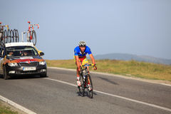 Sipos Zoltan cyclist from Romania team climbing to Paltinis. Paltinis, Sibiu, Romania - 5 July 2012: Sibiu Cycling Tour 2012 - Stage I. Cyclists climbing the Stock Photography