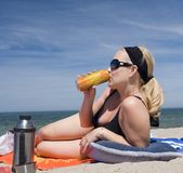 Sipping drinks on the beach Royalty Free Stock Photo