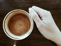Sipping a good coffee. Hand holding a cup of coffee Royalty Free Stock Image