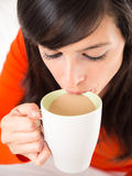 Sipping hot coffee Royalty Free Stock Image