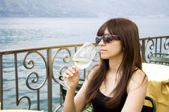 Sipping white wine Stock Photo
