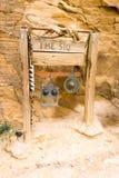 The Siq entrance, Hidden city of Petra, Jordan. Entrance sign to the Siq in the ancient city of Petra, Jordan. The Siq is a small crack in a mountain leading to stock image