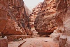 The Siq - narrow entrance to the ancient Nabatean city of Petra Stock Photo
