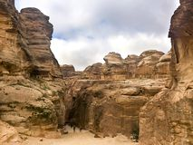 The Siq, the narrow slot-canyon that serves as the entrance passage to the hidden city of Petra Stock Images