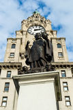 Sir Alfred Lewis Jones memorial in front of the Royal Liver Building. ENGLAND, LIVERPOOL - 15 NOV 2015: Sir Alfred Lewis Jones memorial in front of the Royal royalty free stock photography