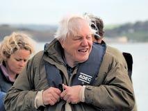 Sir David Attenborough With Local Lyme Regis Firemen imagem de stock royalty free