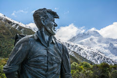 Sir Edmund Hillary Statue looking towards Mount Cook peak, New Zealand. Close-up of the Sir Edmund Hillary Statue looking towards the Mount Cook peak, New stock images
