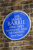 Sir James Barrie Blue Plaque i London Royaltyfri Foto