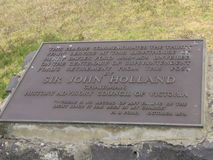 Sir John Holland. This plaque commemorates the thirty years service at this lighthouse of Henry Bayles Ford 1848 - 1878 Unveiled by Sir John Holland royalty free stock photo