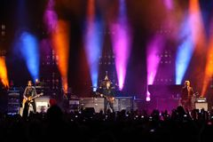 Sir Paul McCartney performs onstage at Olimpiyskiy Stock Photos