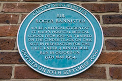 Sir Roger Bannister Plaque in Kilburn. A plaque located in Paddington Recreation Ground in London, marking the area where Sir Roger Bannister trained in royalty free stock photography