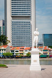 Sir Stamford Raffles statue on Clark Quay in Singapore. With modern buildings on background Royalty Free Stock Image