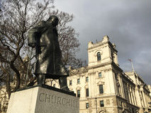 Sir Winston Churchill statue in London. Looking up at the statue of Sir Winston Churchill standing tall n the Westminster area of London, England,United Kingdom stock photos