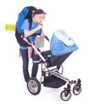 Sira de mãe ao buggy do turista e de bebê foto de stock