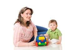 Sira de mãe ao jogo com criança Imagens de Stock
