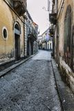 Siracusa, Italy, 08/27/2016: A street in Sicily with old houses in the Italian style against a blue sky royalty free stock photo