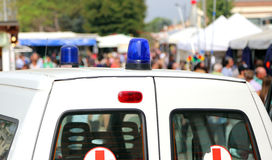 Siren of ambulances during the sporting event. With many people Royalty Free Stock Photos