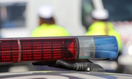 Siren police car during the roadblock Royalty Free Stock Photos