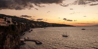 Sorrento to bay sunset. Boats in the evening sunset in Sorrento Bay, Campania, Italy Royalty Free Stock Image