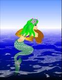 Sirena en el agua Foto de archivo