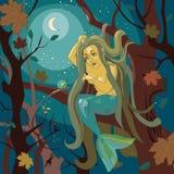 Sirena en un árbol Fotografía de archivo