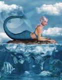 Sirena en una roca Foto de archivo libre de regalías