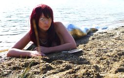 Sirena sulla spiaggia Fotografie Stock