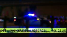 Sirene do carro de polícia com a fita do limite, Defocused Fotos de Stock Royalty Free