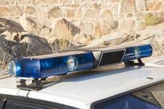 Sirene e luci di vecchio volante della polizia Fotografia Stock