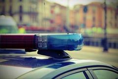 sirenes de carros de polícia durante a patrulha com efeito do vintage Fotos de Stock Royalty Free