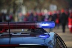 Sirenes de um carro de polícia durante uma demonstração pacífica Imagens de Stock Royalty Free