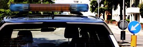 Sirenes do carro de polícia na estrada Fotos de Stock Royalty Free