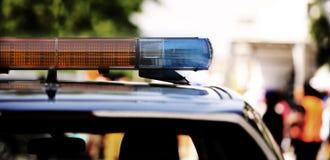 Sirenes van een politiewagen die protesteerders controleert Royalty-vrije Stock Afbeeldingen